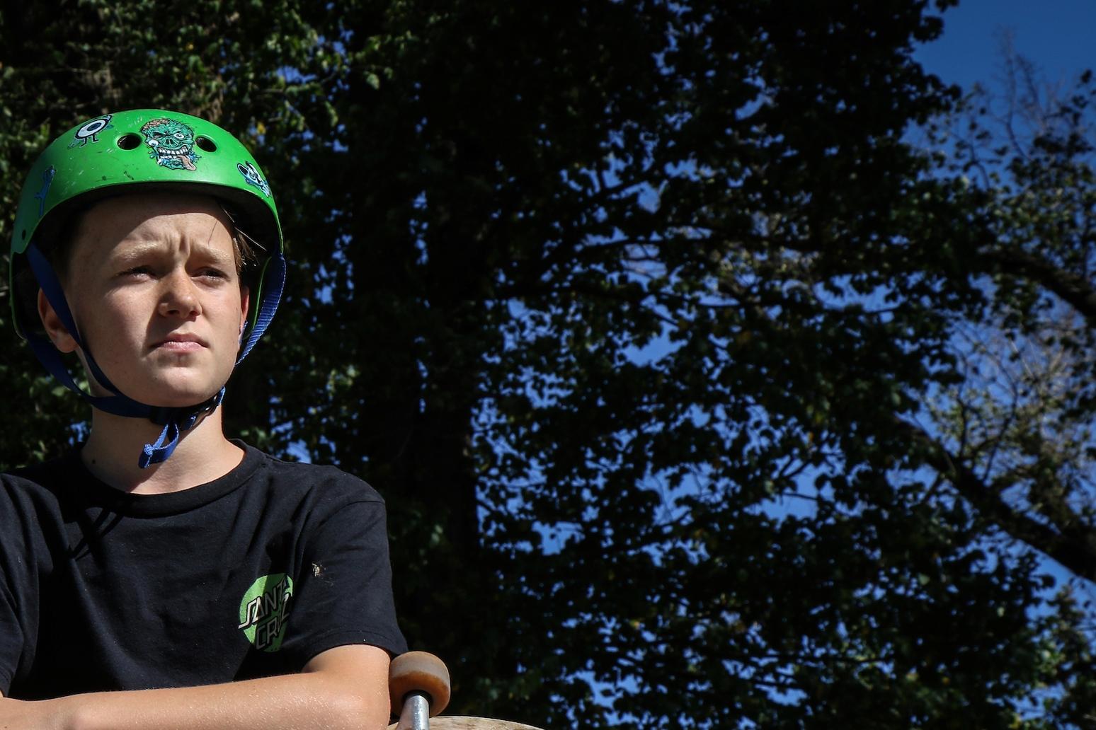 Boy wearing bike helmet in park