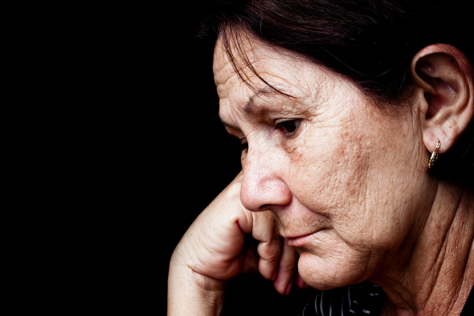 Grieving woman looking sad
