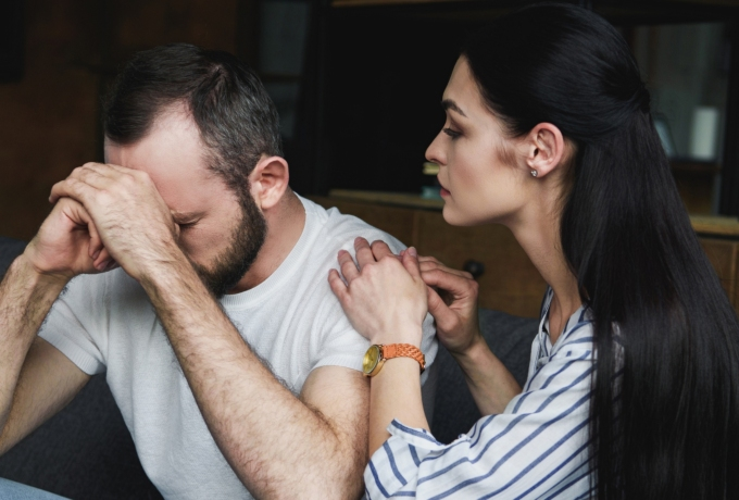 Woman reaching out to partner