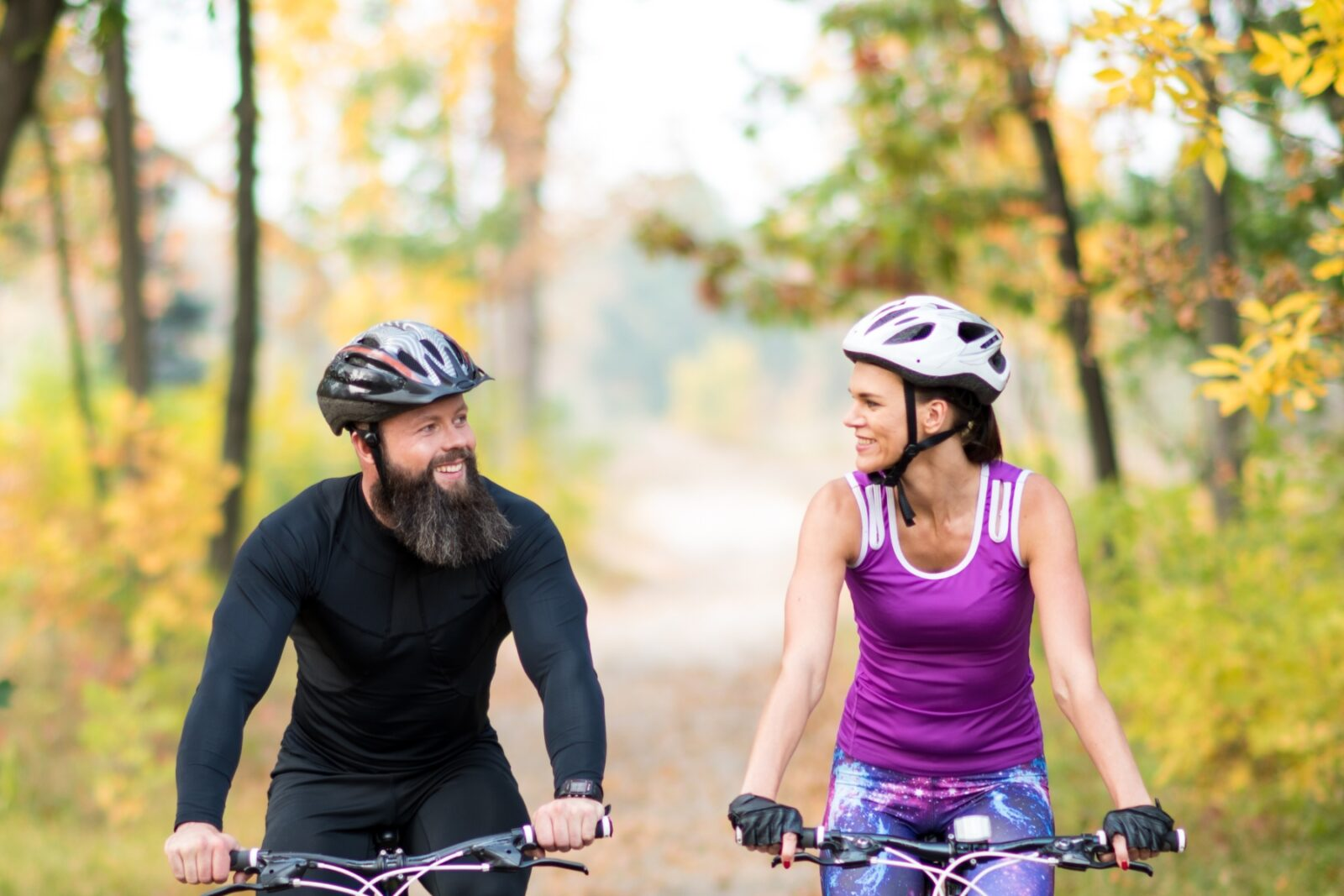 Couple riding bikes on trail