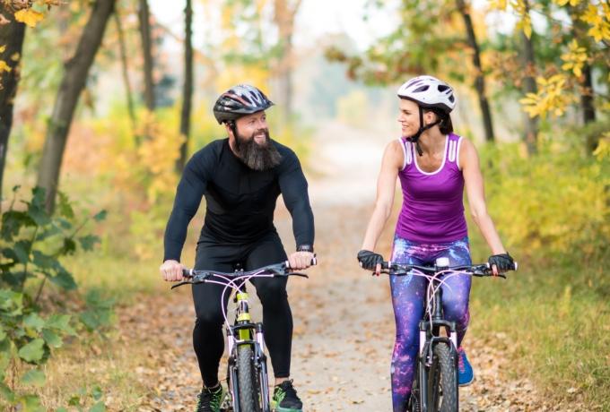 Couple riding bikes on trail