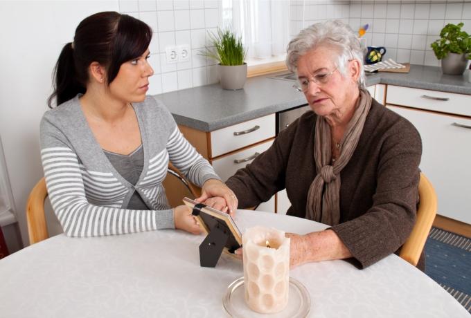 Woman consoling parent following a suicide tile